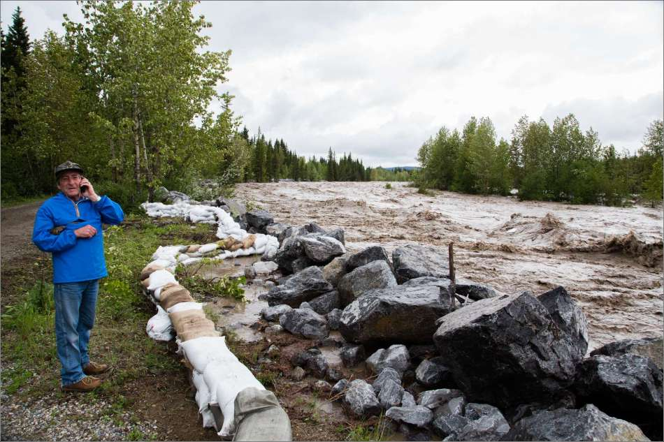 On June 20th the water was still rising when I took this photograph along the bank of the Elbow River.  The water continued to rise for several hours afterwards.  The line of the berm created by the rocks, sandbags and the trees along the left side were all eroded by the river and disappeared by June 21st.