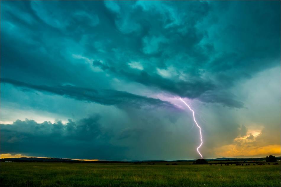 Lightning strikes the ridge above Bragg Creek in Alberta, Canada.