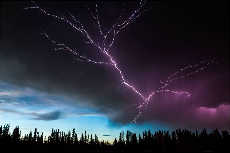 Lightning along the storm's edge, Redwood Meadows, Alberta