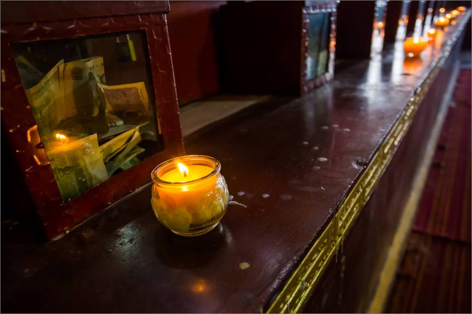 A candle inside Chatreng Khamtsen - © Christopher Martin-6175