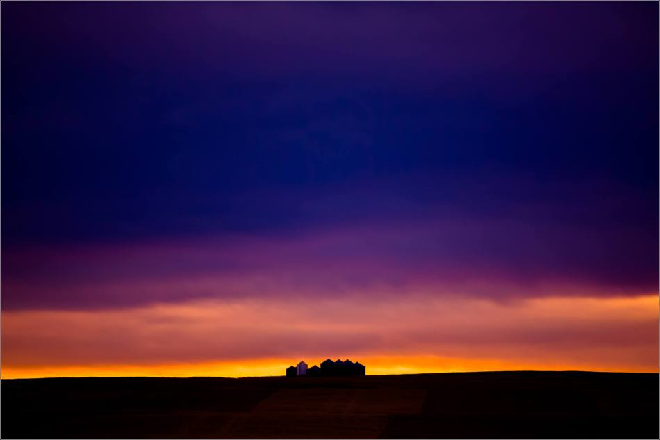 A quiet prairie landscape before dawn near High River, Alberta